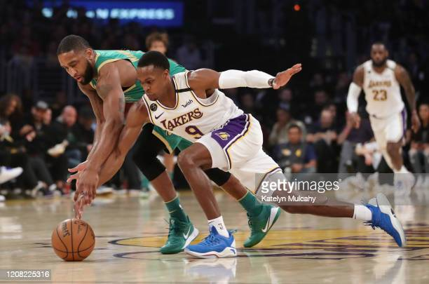 Rajon Rondo of the Los Angeles Lakers fights for the ball from Brad Wanamaker of the Boston Celtics during the second quarter at Staples Center on...