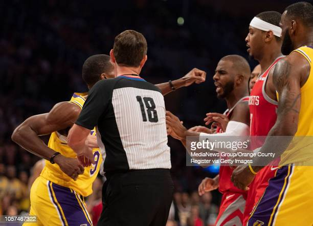 Rajon Rondo of the Los Angeles Lakers punches Chris Paul of the Houston Rockets as referee Matt Boland tries to break it up during the Lakers' home...