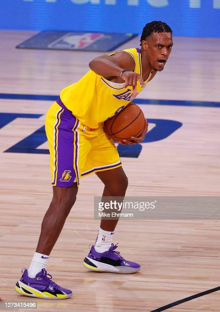 Rajon Rondo of the Los Angeles Lakers sets up a play against the Denver Nuggets during the fourth quarter in Game One of the Western Conference...