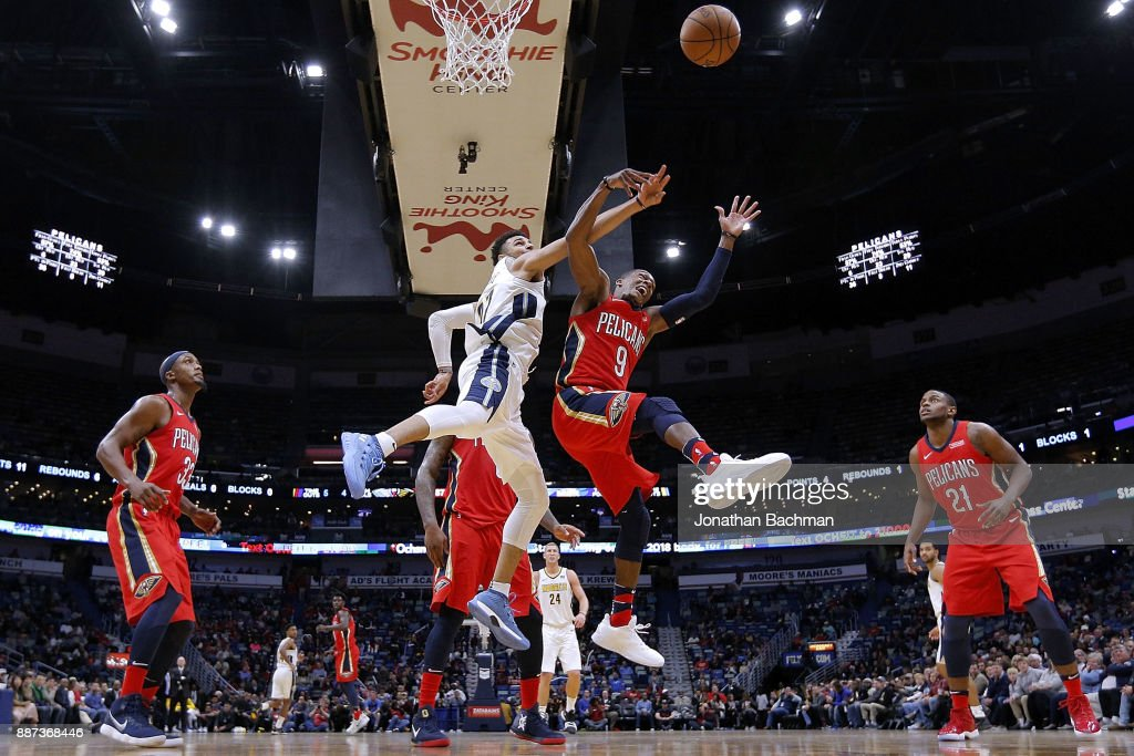 Rajon Rondo #9 of the New Orleans Pelicans and Jamal Murray #27 of the Denver Nuggets go for a rebound during the second half of a game at the Smoothie King Center on December 6, 2017 in New Orleans, Louisiana.