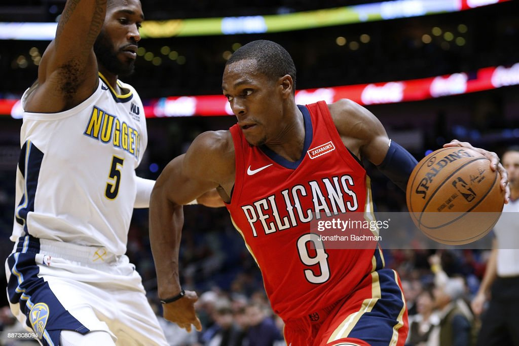 Rajon Rondo #9 of the New Orleans Pelicans drives against Will Barton #5 of the Denver Nuggets during the first half of a game at the Smoothie King Center on December 6, 2017 in New Orleans, Louisiana.
