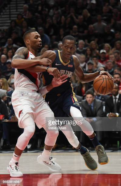 Rajon Rondo of the New Orleans Pelicans drives to the basket on Damian Lillard of the Portland Trail Blazers during the first quarter of game one of...
