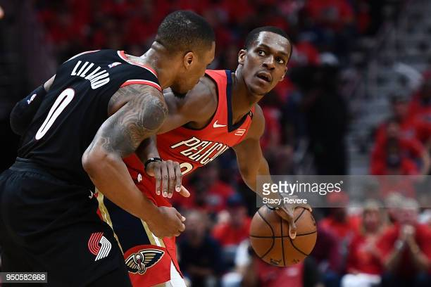 Rajon Rondo of the New Orleans Pelicans is defended by Damian Lillard of the Portland Trail Blazers during Game Four of the first round of the...