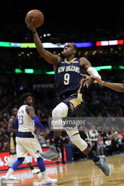 Rajon Rondo of the New Orleans Pelicans makes a layup against the Dallas Mavericks at Smoothie King Center on December 29 2017 in New Orleans...