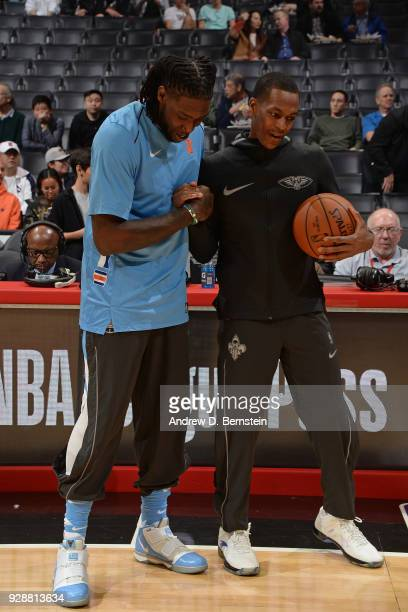 Rajon Rondo of the New Orleans Pelicans shakes hands with Montrezl Harrell of the LA Clippers on March 6 2018 at STAPLES Center in Los Angeles...