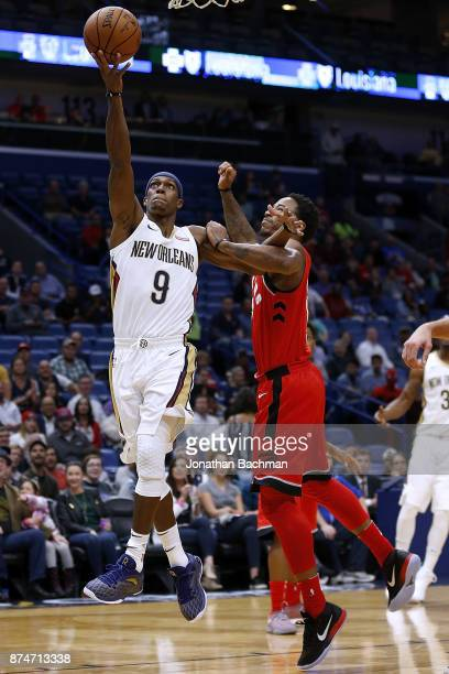 Rajon Rondo of the New Orleans Pelicans shoots against DeMar DeRozan of the Toronto Raptors during the first half of a game at the Smoothie King...