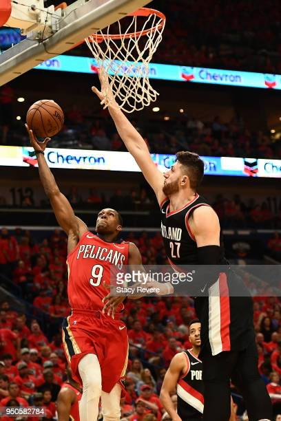 Rajon Rondo of the New Orleans Pelicans shoots over Jusuf Nurkic of the Portland Trail Blazers during Game Four of the first round of the Western...