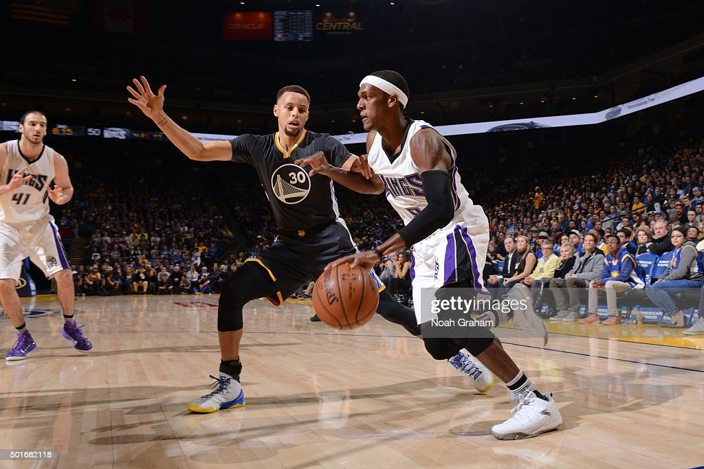 Rajon Rondo #9 of the Sacramento Kings drives to the basket against Stephen Curry #30 of the Golden State Warriors on November 28, 2015 at ORACLE Arena in Oakland, California.