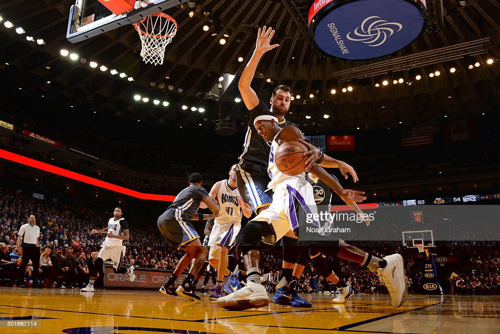 Rajon Rondo #9 of the Sacramento Kings drives to the basket against the Golden State Warriors on November 28, 2015 at ORACLE Arena in Oakland, California.