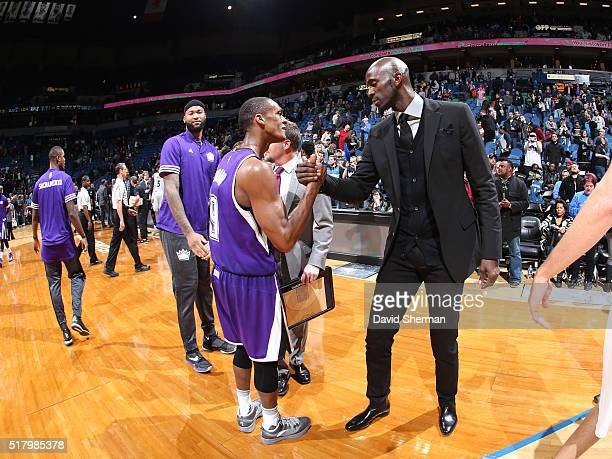 Rajon Rondo of the Sacramento Kings shakes hands with Kevin Garnett of the Minnesota Timberwolves aftetr the game on March 23 2016 at Target Center...