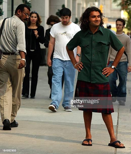 09/10/03 KILT Raju Mudhar wears a kilt on Yonge Street gets a few looks for 1st person yarn TONY BOCK/TORONTO STAR