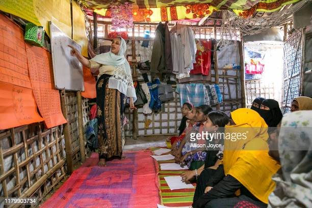 Rajum teaches women in a shelter in the camp on October 28, 2019 in Cox's Bazar, Bangladesh. 27 year old Rohingya refugee Shamima Bibi is currently...