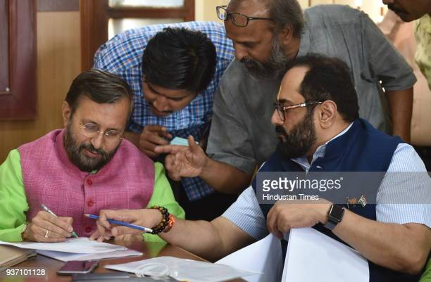 Rajya Sabha candidate Rajeev Chandrasekhar with the union minister Prakash Javadekar during Rajya Sabha election at Vidhan Soudha on March 23 2018 in...