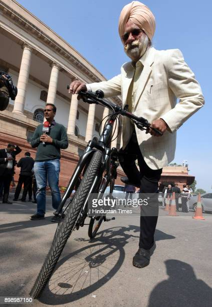 Rajya Sabha MP and Lawyer KTS Tulsi with his cycle during the Parliament Winter Session on December 27 2017 in New Delhi India Impasse in Rajya Sabha...