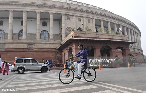 Rajya Sabha MP Mansukh L Mandaviya arrives on his cycle at Parliament during the winter session on December 7 2015 in New Delhi India The third week...