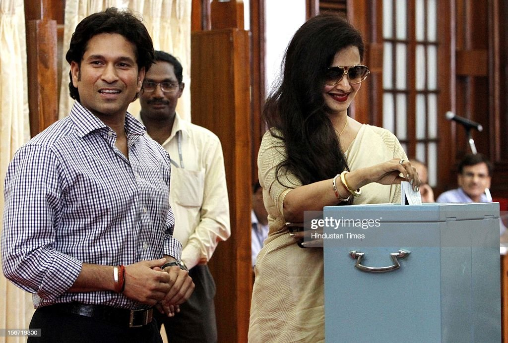 'NEW DELHI, INDIA - AUGUST 7: Rajya Sabha MP, Sachin Tendulkar looks on as Rekha casting her vote for the election of Vice President at Parliament house on August 7, 2012 in New Delhi, India. (Photo by Sunil Saxena/Hindustan Times via Getty Images)'