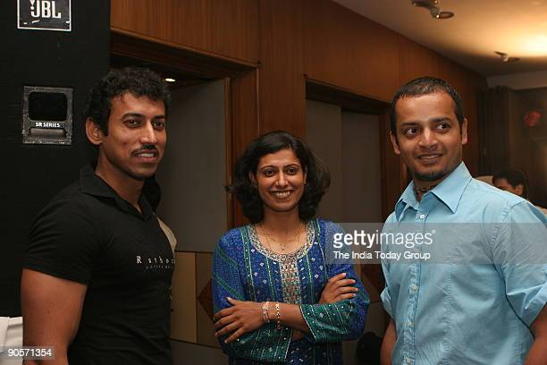 Rajyavardhan Singh Rathore shooter Anjum Chopra and Murali Kartik at the launch of book 'The Commonwealth Journey from Melbourne to New Delhi' in New...