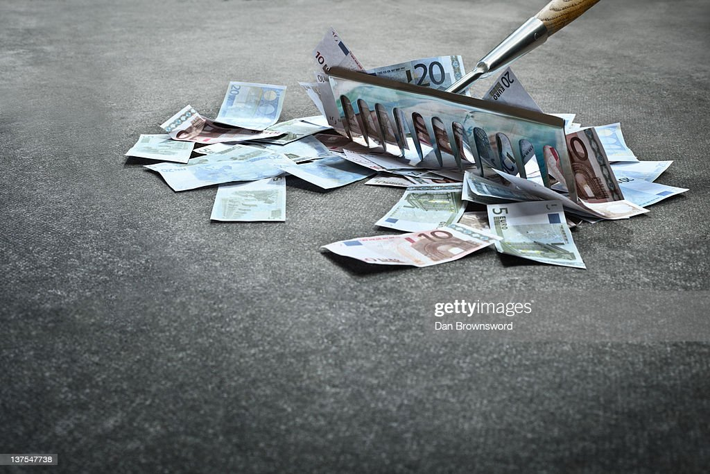 Rake collecting Euro notes : Stock Photo