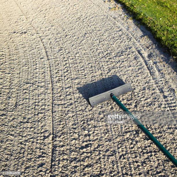 rake in a sand trap on a golf course - bradenton stock pictures, royalty-free photos & images