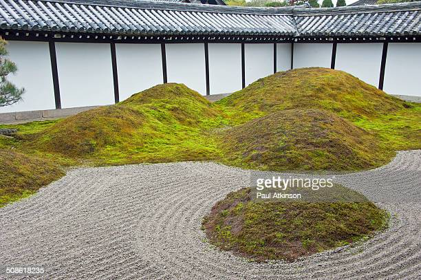 Raked gravel stone and moss garden in a temple in Kyoto, Japan.