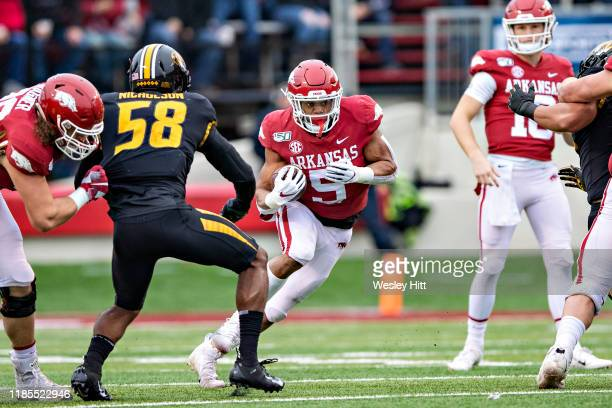 Rakeem Boyd of the Arkansas Razorbacks runs the ball up the middle during the first half of a game against the Missouri Tigers at War Memorial...