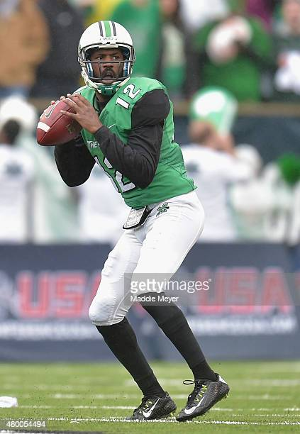Rakeem Cato of the Marshall Thundering Herd looks to pass during the first quarter against the Louisiana Tech Bulldogs at Joan C Edwards Stadium...