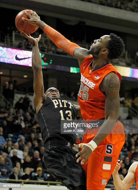 Rakeem Christmas of the Syracuse Orange blocks a shot by Josh Newkirk of the Pittsburgh Panthers during the game at Petersen Events Center on...