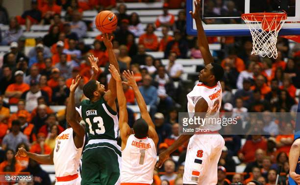Rakeem Christmas of the Syracuse Orange blocks the shot with the help of Michael Carter-Williams and C.J. Fair against Antonio Green of the Eastern...