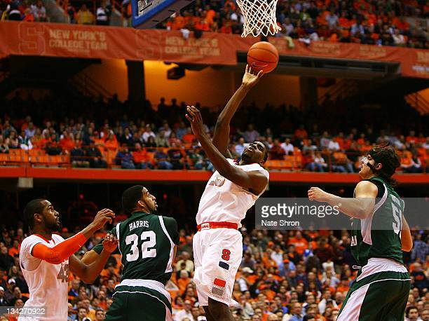 Rakeem Christmas of the Syracuse Orange shoots the ball against Jamell Harris and Kamil Janton of the Eastern Michigan Eagles during the game at the...