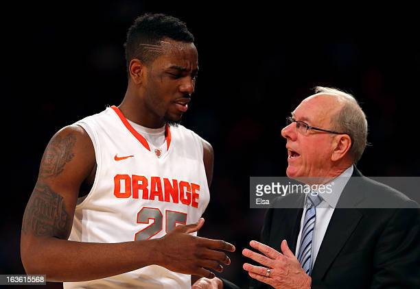 Rakeem Christmas of the Syracuse Orange speaks to head coach Jim Boeheim in the second half against the Seton Hall Pirates during the second round of...