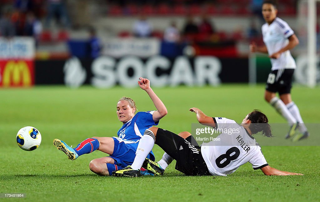 Rakel Hoennudottir (L) of Iceland and Nadine Kessler (R) of Germany battle for the ball during the UEFA Women's Euro 2013 group B match between Iceland and Germany at Vaxjo Arena on July 14, 2013 in Vaxjo, Sweden.