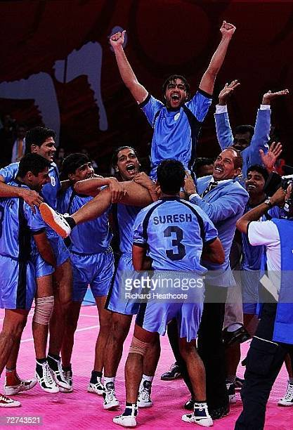 Rakesh Kumar of India celebrates atop his team mates shoulders after winning the gold medal by defeating Pakistan in the Men's Kabaddi Gold Medal...
