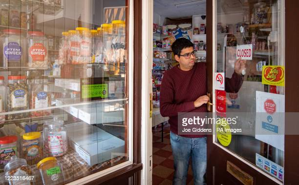 Rakesh Parmar closes up Ye Olde Sweet Shoppe in Leicester after the Health Secretary Matt Hancock imposed a local lockdown following a spike in...