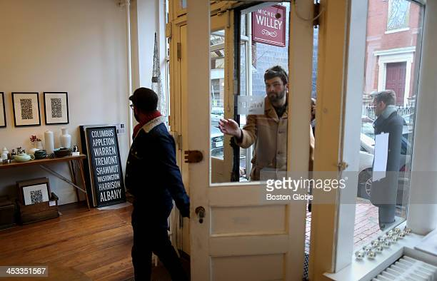 Rakesh Satyal left and John Maas right in door visit Michelle Willey a home and gift store in Boston's South End on Saturday Nov 30 2013 After Black...