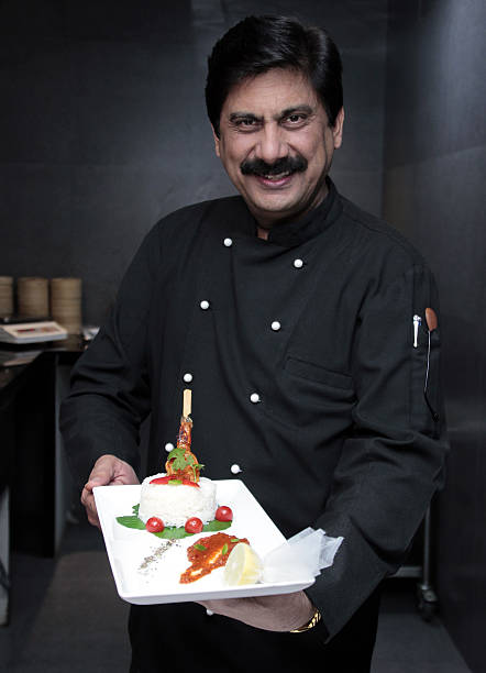 Profile shoot of chef rakesh sethi photos and images getty images rakesh sethi executive chef at radisson blu posing with his recipe sushi doughnut with forumfinder Images