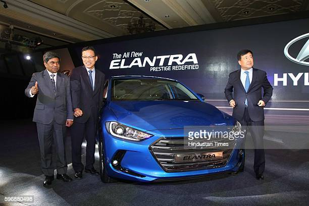Rakesh Srivastava, senior VP , HMIL, BS Jeong, Director , and Hyundai Motor India MD and CEO YK Koo pose during the launch of new sixth generation...