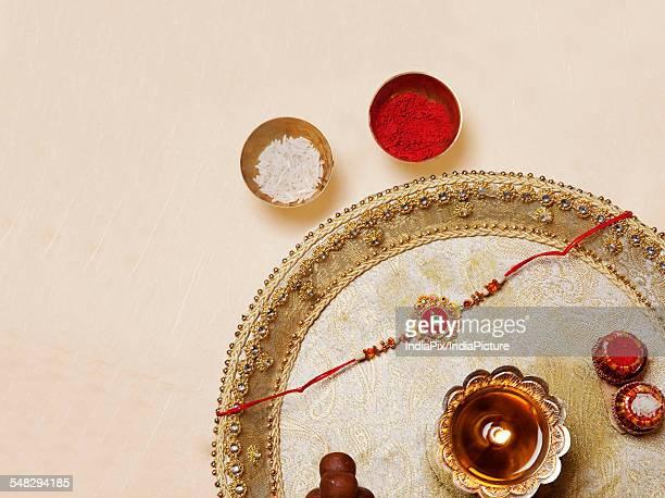 rakhi and diya in a tray - raksha bandhan stock photos and pictures