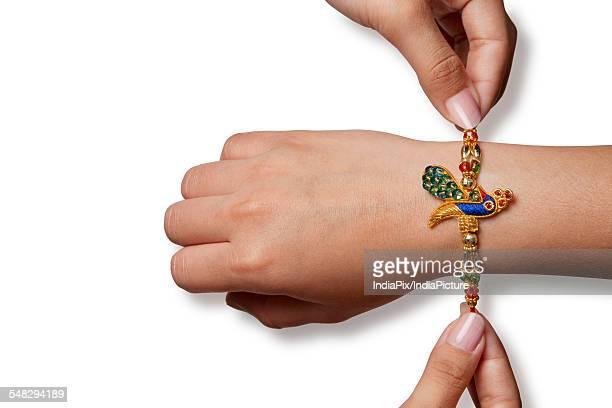 Rakhi on a boys hand