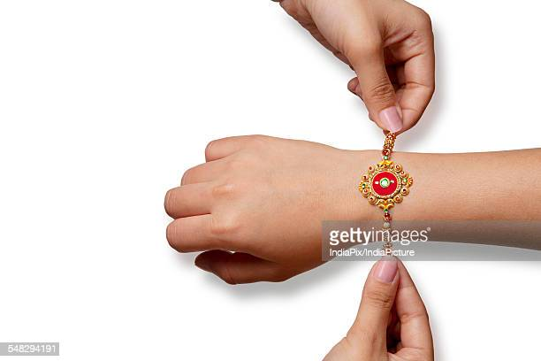 rakhi on a boys hand - raksha bandhan stock photos and pictures