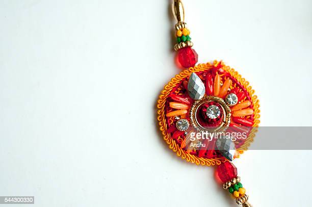 rakhi on a white background - diwali sweets stock photos and pictures
