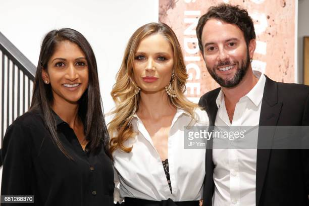 Rakhi Patel Georgina Chapman and Justin Reeves attend 'A Magic Bus Cocktail Party' at DAG Modern on May 9 2017 in New York City