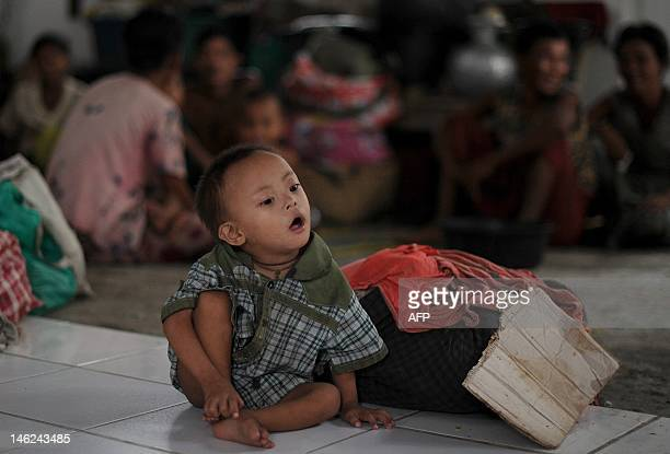 Rakhine child sits at a monastery used as a temporary shelter for people displaced by ongoing violence in Sittwe, capital of Myanmar's western state...