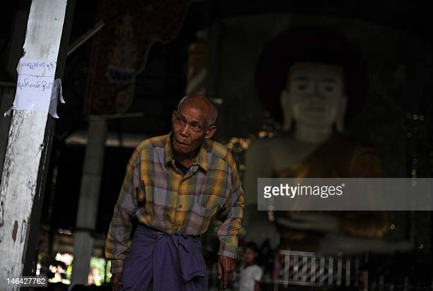 A Rakhine man walks at a monastery used as a temporary shelter for people displaced by days of sectarian violence in Sittwe capital of Myanmar's...