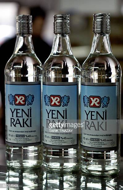 Raki bottles stand in a shop window in Ankara 01 March 2005 Five people have died after drinking counterfeit raki a traditional Turkish drink made of...