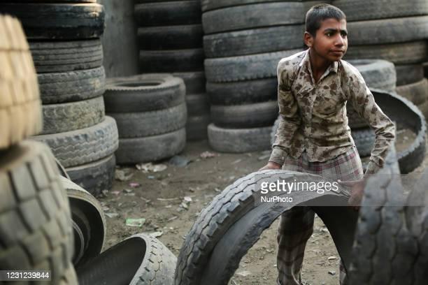 Rakib , works at a tire recycling factory in Dhaka, Bangladesh on Thursday, February 18, 2021.