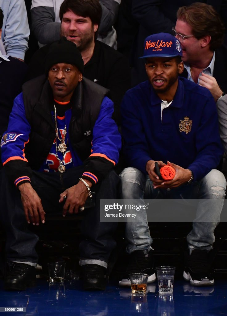 Rakim and guest attend the New York Knicks Vs Boston Celtics game at Madison Square Garden on December 21, 2017 in New York City.