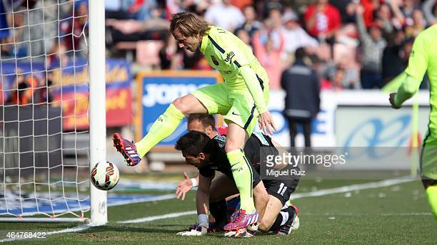Rakitic of FC Barcelona scores the first goal during the La Liga match between Granada CF and FC Barcelona at Estadio Nuevo Los Carmenes on February...