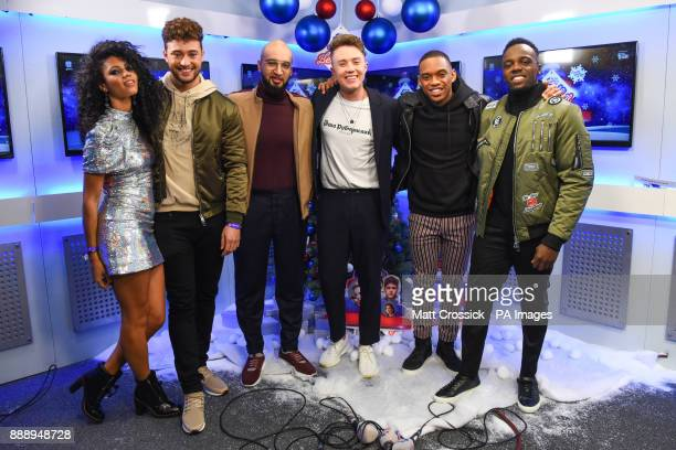 RakSu are interviewed backstage by Roman Kemp and Vick Hope during day one of Capital's Jingle Bell Ball 2017 at the O2 Arena London