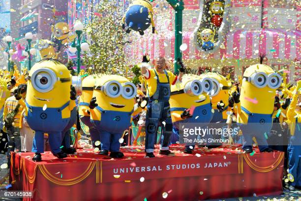 Rakugo performer Shofukutei Tsurube and minions attend the opening ceremony of the new attraction 'Minion Park' at the Universal Studios Japan on...