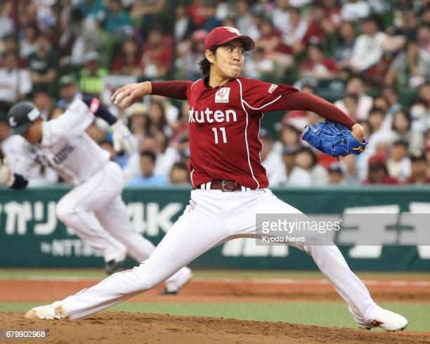 Rakuten Eagles' Takayuki Kishi pitches during a game against the Seibu Lions at MetLife Dome just outside Tokyo on May 7 2017 Rakuten beat Seibu 32...